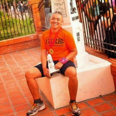 Bien at the Km 102 Marker at old train station in San Fernando, Pampanga - the finish line of Bataan Death March 102.